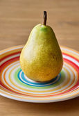 Pear on the plate — Stock Photo