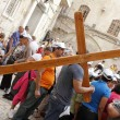 Carrying his cross Jerusalem - Stockfoto