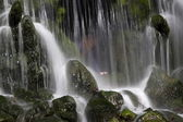 Visitor stands behind the Grand Waterfall in park Sonsbeek in Arnhem, Netherlands — Stock Photo