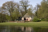Pond and farm and restaurant Brasserie in Sonsbeek park in Arnhem, Netherlands — Stock Photo
