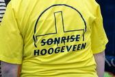 Back of t shirt employee of Sonrise, an interdenominational community in Hoogeveen, Netherlands — Stock Photo