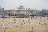 The beach with a backdrop of the Kurhaus in Scheveningen, Netherlands — Stock Photo