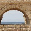 Looking to the Mediterranean through the arch of the Aqueduct, Caesarea, Israel — Stock Photo
