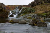The waterfall in the mountain valley Iceland — Stock Photo