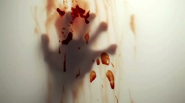 Blood-stained hand behind glass — Stock Video