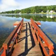 Red dock, beautiful lake — Stock Photo