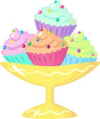 Cupcakes in the bowl — Stock Vector