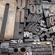 Old die press letters and numbers — Stock Photo #14306107