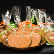 Homemade pumkin cookies on isolated black - Stock Photo