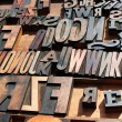 A bunch of old vintage wooden block printing press letters. — Stock Photo