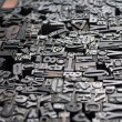 Stock Photo: Old die press letters and numbers