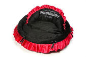 Red and black dog bed. — Stock Photo