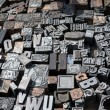 Old die press letters and numbers — Stock Photo #14310891