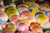 Wall of colorful knit bowls — Stock Photo