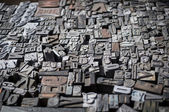 Old die press letters and numbers — Stock Photo