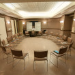 Stock Photo: 12 step recovery meeting room with chairs