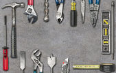 Group of used tools on concrete — Stock Photo