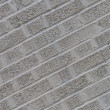 Gray angled brick wall background — Stock Photo #21703715