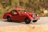 Retro model car in the garden. — Stock Photo