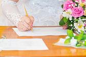 Signature of the bride — Stock Photo