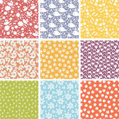 Set of nine cute elements seamless patterns backgrounds — Stock Vector