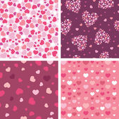 Set of four romantic hearts seamless patterns backgrounds — Stok Vektör