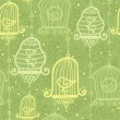 Birds in cages seamless pattern background — Stock Vector