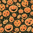 Halloween pumpkins seamless pattern background — ベクター素材ストック