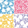 Set of four floral silhouettes seamless patterns backgrounds — Stock vektor
