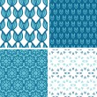 Four abstract blue tulip shapes seamless patterns set — Stock Vector
