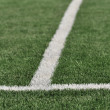 Stock Photo: Lines intersect on a turf field of play.