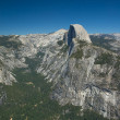 Stock Photo: Clear skies let the sun shine down on Half Dome inside of Yosemitie National Park.