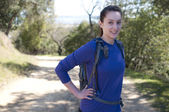 Centered hiker woman in blue long sleeve shirt looks at camera — Stock Photo