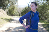 Hiker woman in blue long sleeve shirt looks away to left — Stock Photo