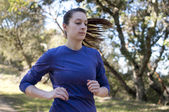 Very close up of woman jogging, facing right, empty space right — Stock Photo