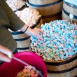 A woman reaches for blue salt water taffy - Stock Photo