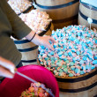 A woman reaches for blue salt water taffy — Stock Photo