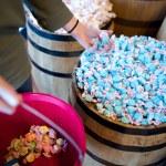 A woman has a handfull of blue salt water taffy — Stock Photo