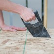 Side view of a man using a hand saw — Stock Photo #26741039