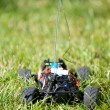 Vertical of toy RC truck in grass, no body — Stock Photo