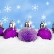 Baubles in the snow — Stock Photo