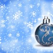 Stock Photo: Blue Christmas bauble with a snow backround