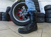 Wheel at tire service — Stockfoto
