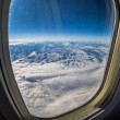 Stock Photo: Mountains from plane