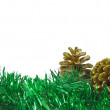 Fir-tree garland and gold cones - Stock Photo