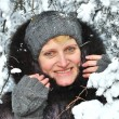 Portrait of the woman against snow-covered trees in the winter — Stock Photo
