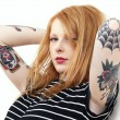 Strawberry Blonde Red Head Leaning Against Wall with Tattoo Arms — Stock Photo