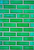 Green brick wall with white cement — Stock Photo