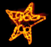 Out of focus fairy light Christmas star — Stock Photo