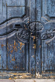 Rustic Spanish door with flaking paint — Stock Photo